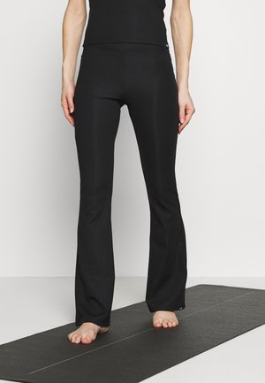 LEGGING FLARED - Tracksuit bottoms - black