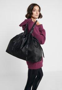Hunkemöller - TOTE BAG - Sports bag - black - 1