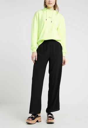 MOJA TROUSERS - Trousers - black