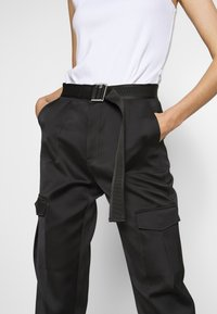 Holzweiler - SKUNK - Cargo trousers - black - 6