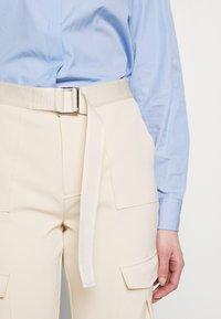 Holzweiler - SKUNK - Cargo trousers - ecru - 7