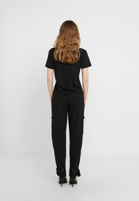 Holzweiler - SUZANA TEE - T-shirt basique - black - 2