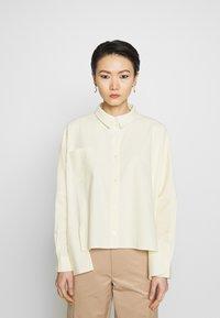 Holzweiler - SON - Button-down blouse - light yellow - 0