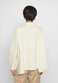 Holzweiler - SON - Button-down blouse - light yellow - 2