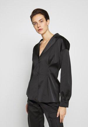 RIOT - Halflange jas - black