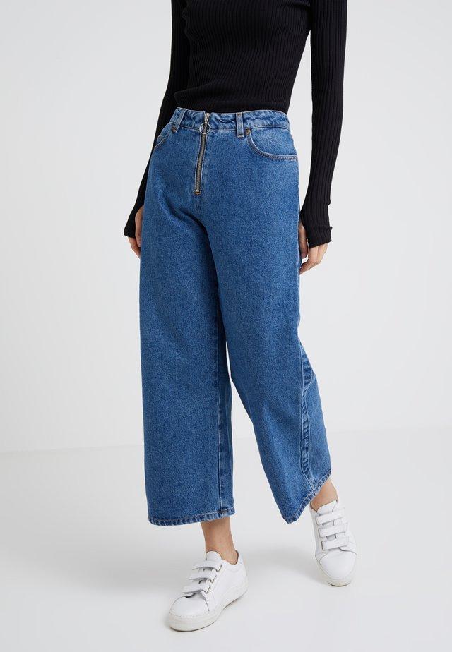 LEONORA - Flared Jeans - light blue