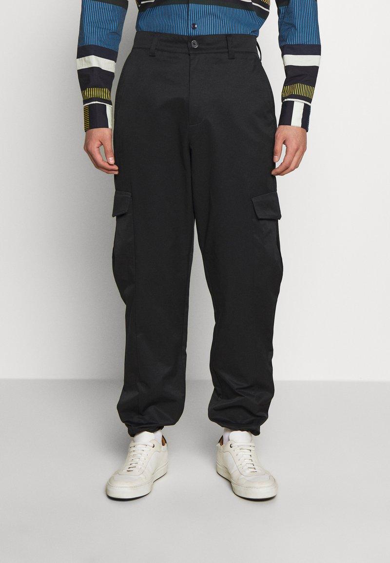 Holzweiler - PIMP TROUSER - Cargo trousers - black