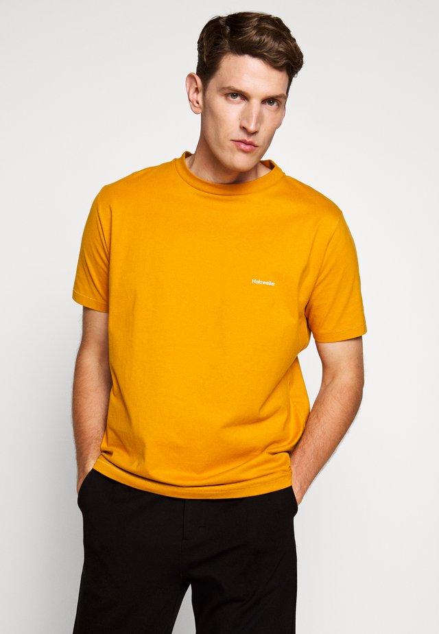 LIVE TEE  - Basic T-shirt - ocher yellow