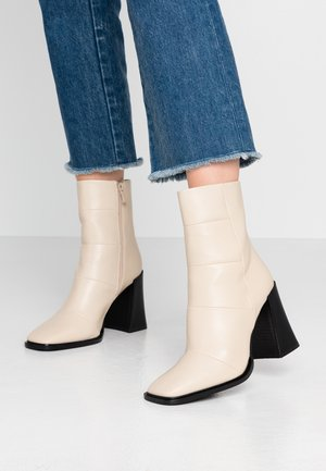 High heeled ankle boots - cream