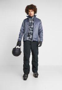 Houdini - UP JACKET - Snowboard jacket - spokes blue - 1