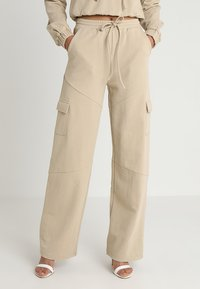 Honey Punch - HIGH WAISTED FLARED PANTS - Tracksuit bottoms - beige - 0