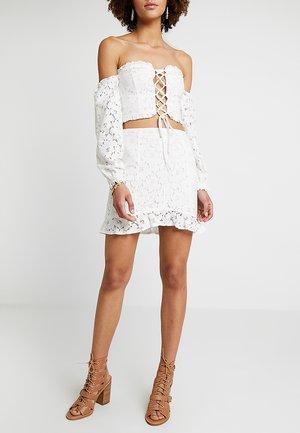 SKIRT WITH RUFFLE HEM - Mini skirt - white