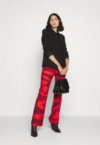 HOSBJERG - PALOMA PANTS - Trousers - red - 1