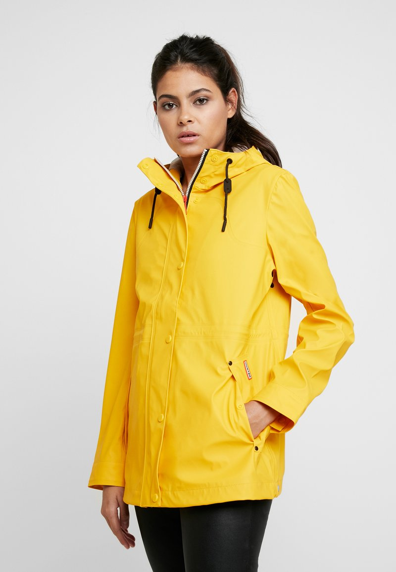 Hunter - WOMENS ORIGINAL LIGHTWEIGHT RUBBERISED JACKET - Parka - yellow