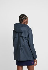 Hunter - WOMENS ORIGINAL LIGHTWEIGHT RUBBERISED JACKET - Parkas - navy