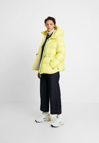 Hunter ORIGINAL - WOMENS ORIGINAL ALINE PUFFER - Winter jacket - yellow