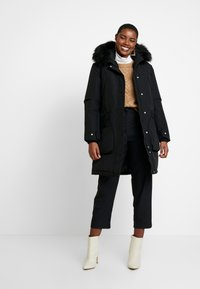 Hunter ORIGINAL - WOMENS ORIGINAL INSULATED - Winter coat - black - 1