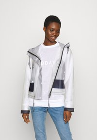 Hunter ORIGINAL - WOMENS ORIGINAL HERO CROPPED SMOCK - Waterproof jacket - white/navy/limpit - 0