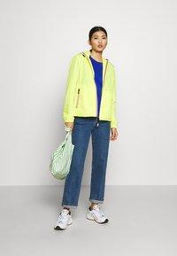 Hunter - WOMENS ORIGINAL SHELL JACKET - Waterproof jacket - yellow - 1