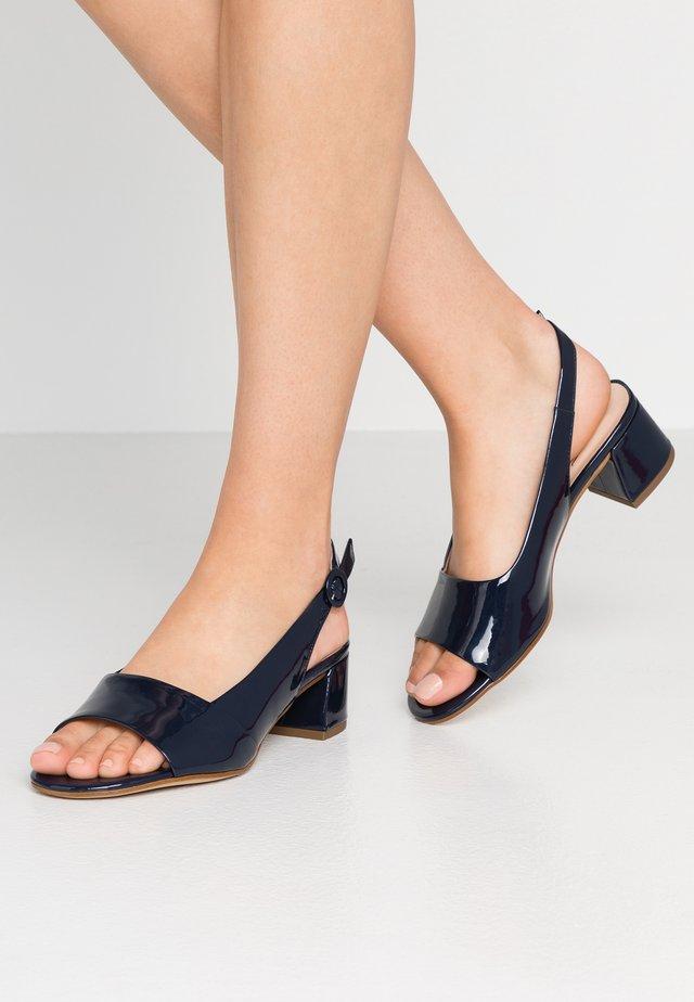 Sandaalit nilkkaremmillä - blue