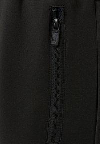 Hummel - HMLCANGO - Træningsbukser - black - 3