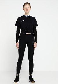 Hummel - HMLGO  - Print T-shirt - black - 1