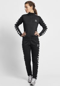 Hummel - HMLNELLY  - Training jacket - caviar - 1