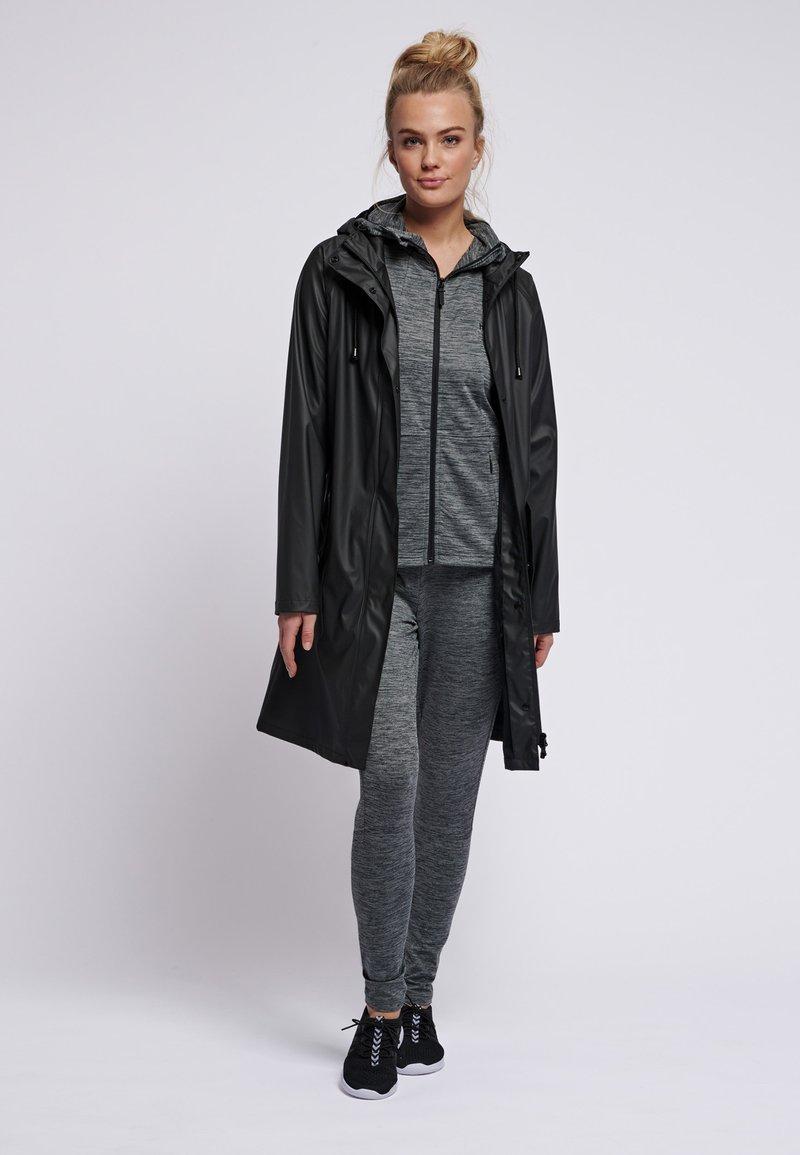 Hummel - HMLJOY  - Regnjakke / vandafvisende jakker - black