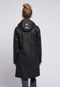 Hummel - HMLJOY  - Regnjakke / vandafvisende jakker - black - 2