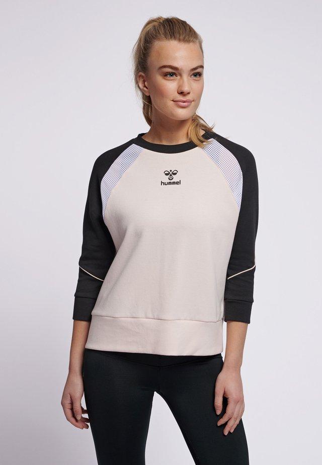 HMLNIRVANA  - Stickad tröja - cloud pink