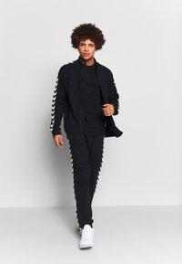 Hummel - MOVE - Camiseta estampada - black - 1