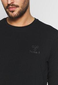 Hummel - SIGGE - Long sleeved top - black - 4