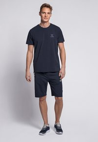 Hummel - HMLSIGGE - Print T-shirt - black iris - 1
