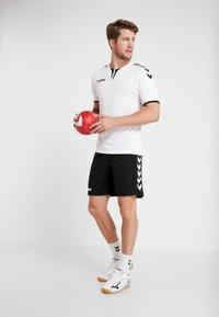 Hummel - CORE SHORTS - kurze Sporthose - black - 1