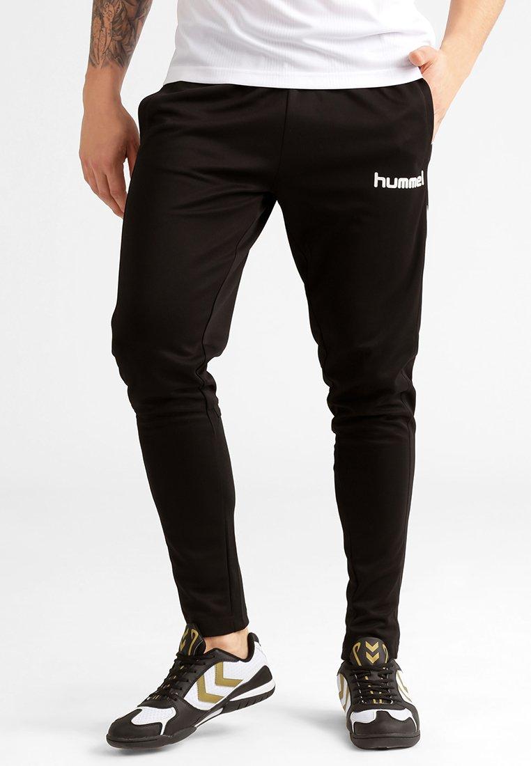 Hummel - CORE - Tracksuit bottoms - black