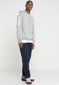 Hummel - HMLGO COTTON PANT - Pantalones deportivos - marine - 1