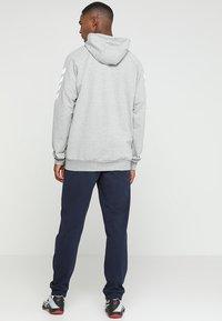 Hummel - HMLGO COTTON PANT - Pantalones deportivos - marine - 2