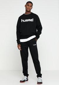 Hummel - HMLGO COTTON PANT - Joggebukse - black - 1
