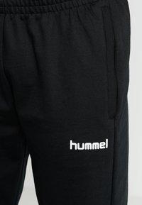 Hummel - HMLGO COTTON PANT - Joggebukse - black - 4