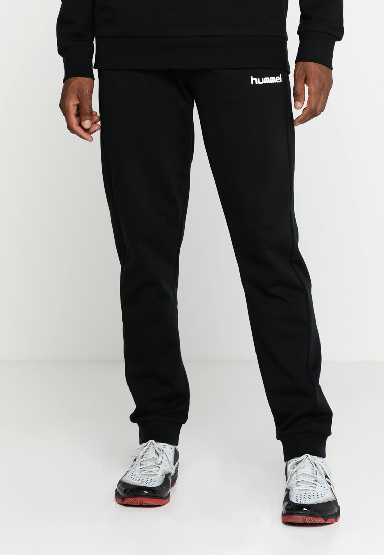 Hummel - HMLGO COTTON PANT - Pantalon de survêtement - black