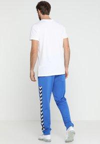 Hummel - HMLNATHAN PANTS - Joggebukse - blue - 2