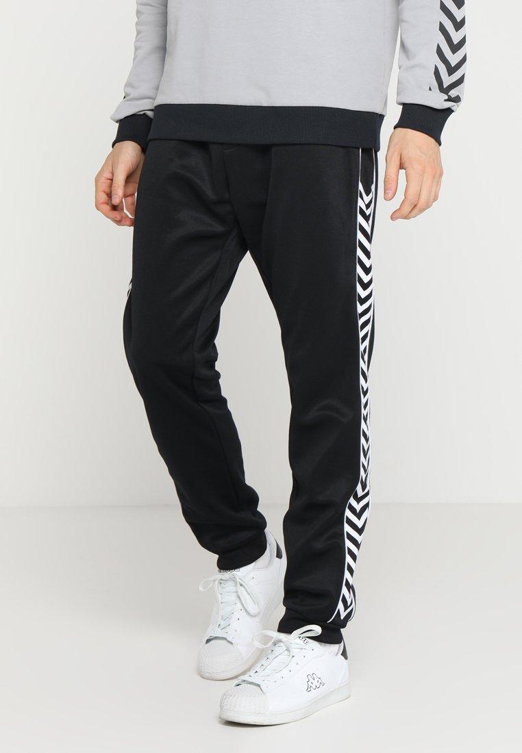 Hummel Hive - HMLASTON PANTS - Pantalones deportivos - black