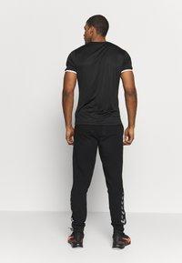 Hummel - AUTHENTIC PANT - Pantalones deportivos - black/white - 2