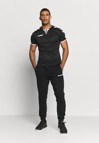 Hummel - AUTHENTIC PANT - Pantalones deportivos - black/white - 1