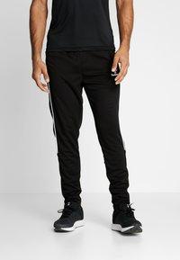 Hummel - TAPERED PANTS - Jogginghose - black - 0