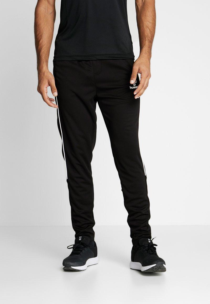 Hummel - TAPERED PANTS - Jogginghose - black