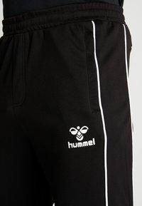 Hummel - TAPERED PANTS - Jogginghose - black - 4