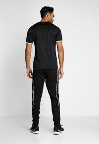 Hummel - TAPERED PANTS - Jogginghose - black - 2