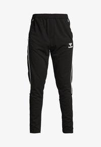 Hummel - TAPERED PANTS - Jogginghose - black - 3