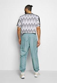 Hummel - MAGNUS PANTS - Pantaloni sportivi - quarry - 2